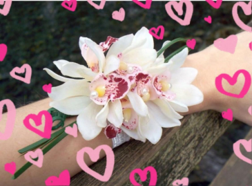 Mother's Day Double Orchid Wrist Corsage  Adored with ribbon and glitz.