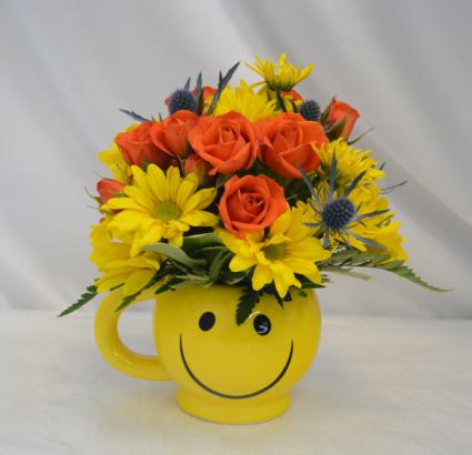 MUG SHOT SMILE Flower Arrangement