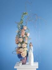 Multi-colored flowers in vase (figurines not inclu