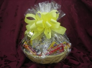 MUNCH BASKET Basket filled with candy and snacks in Berwick, LA | TOWN & COUNTRY FLORIST & GIFTS, INC.