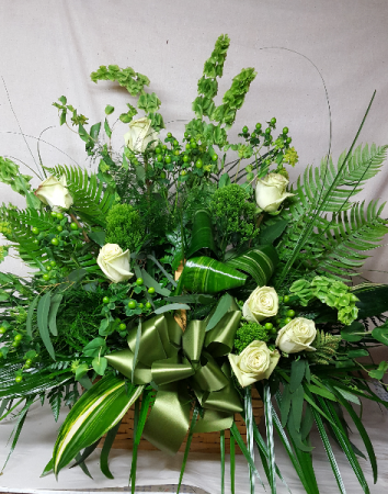 Natures Verde Sympathy Basket wicker basket for sympathy of a lush foliage and green rose to pop the greens