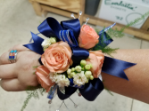 navy and orange  corsage