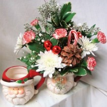 Cute Santa mug with red and white flowers,  candy cane and red balls arranged!