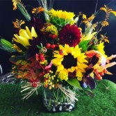 Sunflower arrangement in cube vase