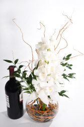 Night of romance white cymbidium orchid with wine