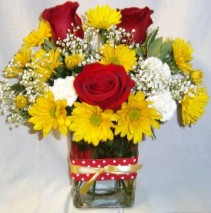 "'WHITE CARNATION FLOWER"" IN A CUTE CUBE vase with RED AND YELLOW polka dot ribbon and red roses, yellow daisies and white carnations with baby's breath!!"