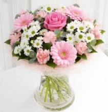 SORORITY PINK AND WHITES!!  1 PINK ROSE, WHITE  DAISIES AND PINK GERBERA DAISIES WITH PINK MINI CARNATIONS  ALL ARRANGED IN A CLEAR VASE!!