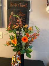 October dreams Fall mixed vase arrangement with bat  and ribbon