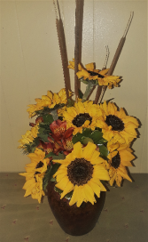 October Sun Sun flowers in ceramic vase.