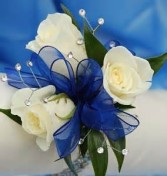 3 white sweetheart roses wrist corsage with  baby's breath with your choice of ribbon.(More corsages on prom link)