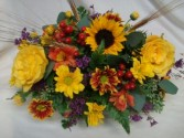 Thanksgiving centerpiece with roses and other fall bright seasonal flowers. Low and long arranged for your table.