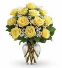 Dozen Yellow Roses arranged in vase with filler!