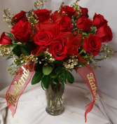 Vase arrangement of Red Roses and wax flower or baby's breath with a Bow and  optional script.