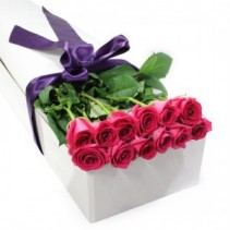 One Dozen Colored Roses  In a box on water tubes with accent flowers