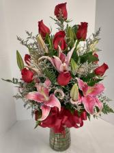 one dozen Ladies Favorite Roses and Stargazers