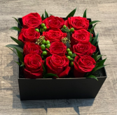 One dozen Red Roses Boxed with Lid and Bow Included
