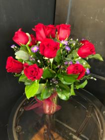 One dozen roses in cylinder vase