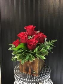 One Dozen Roses in Signature #FLOWERS Container