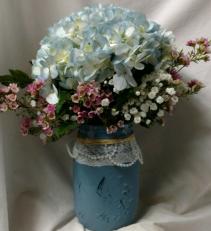 One pretty blue hydrangea in a mason jar with Wax flower!