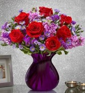 PURPLE PASSION! Red Roses with purple flowers all arranged in a purple or red vase!!