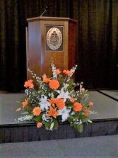 Orange and white arrangement Podium arrangement