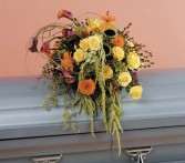 Orange and Yellow cascading Funeral flowers Red Rock Florist