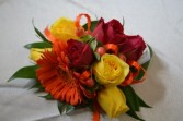 orange and yellow wrist corsage