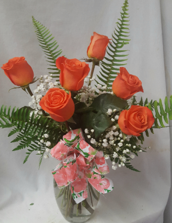 Orange Crush Delight! Six orange roses arranged  in a vase with baby's breath and bow!
