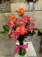 Orange to pink vase arrangement