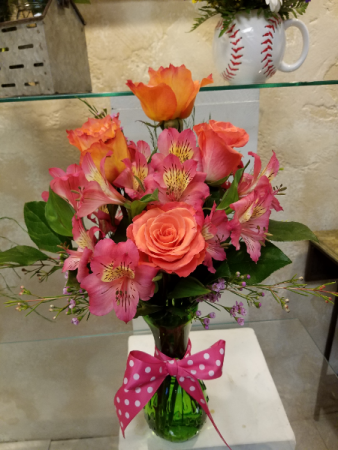 Orange to pink vase arrangement