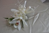 small white orchid  pin on corsage