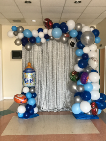 Organic swag any theme with short columns variable sizes of latex and Mylar balloons not backdrop