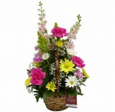 OUR THOUGHTS ARE WITH YOU Wicker basket filled with a colorful arrangement of flowers