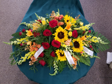 Outdoorsy Casket Spray  Funeral Arrangement