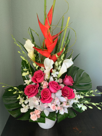 PARADISE ARRANGEMENT ELEGANT MIXTURE OF TROPICAL FLOWERS