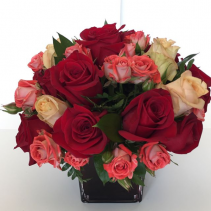 Passion Beautiful arrangement on red cube base