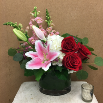 Passionate Embrace Lilies, Snapdragons, Hydrangea, and Deep Red roses