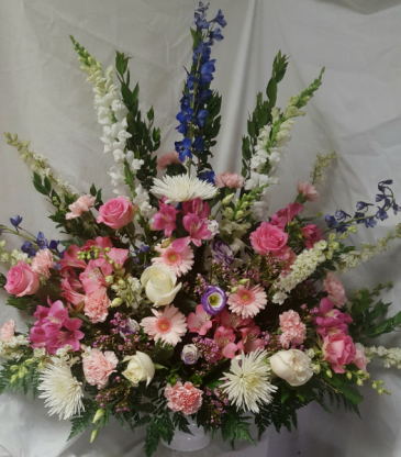 """Pastel Flowers""...pinks, whites, and lavenders  Funeral arrangement."