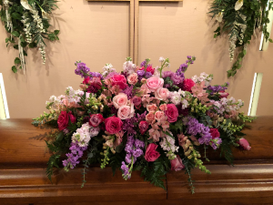Pastel Tradition Casket Spray Shades of pinks, lavenders and peaches in North Bend, OR | PETAL TO THE METAL FLOWERS