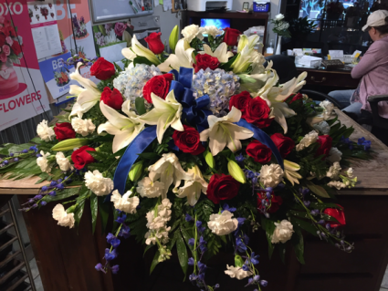 Patriotic bliss  Red white and blue casket spray