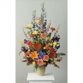 Peaceful Array  Mixed flowers that are available in season