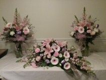 Peaceful Pink Viewing Casket cover with matching vases