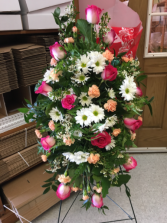 Peach and pink tribute Funeral spray