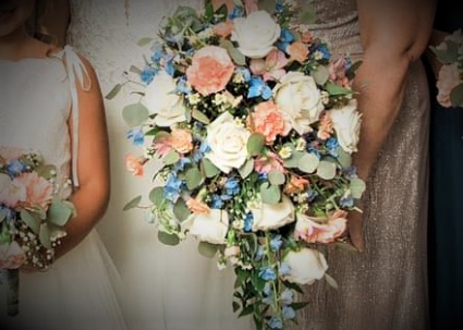 Peaches and blue cascading bouquet