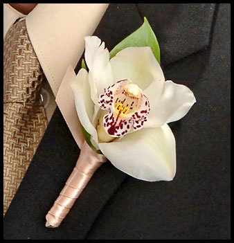 perfect orchid  boutonniere
