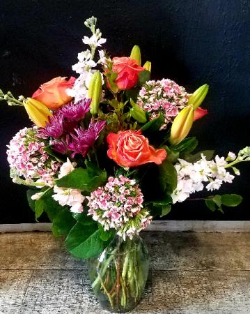 Petals & Vines Orange Roses Vased arrangement