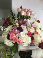 Pick me up Roses  Roses. Mixed colors, orchids, fillers