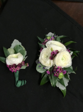 piece of purple boutonniere and corsage