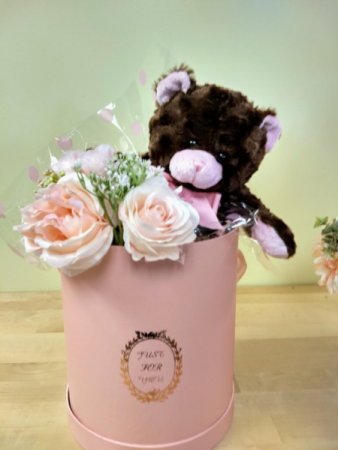 pink and brown bear with hand tied silk bouquet in a hat box