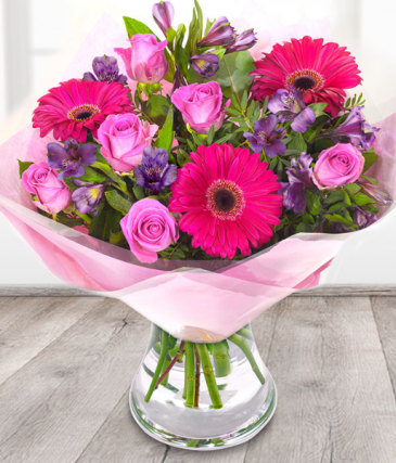 pink and lavender bouquet  in vase